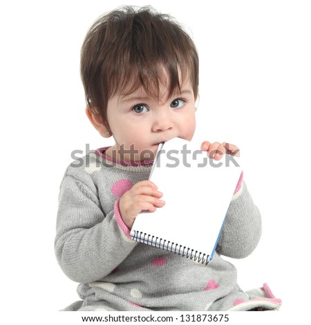 Baby holding and biting a blank notebook on a white isolated background - stock photo