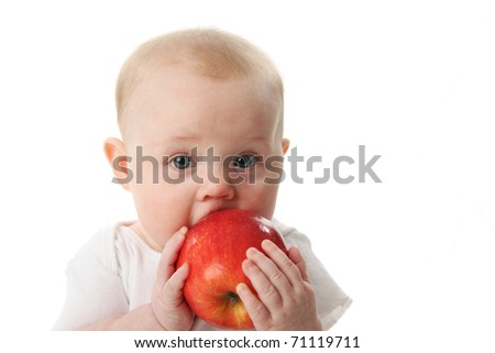 Baby holding and eating an apple, isolated on white - stock photo