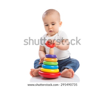 Baby holding and playing with education toys isoalted - stock photo