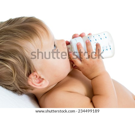 baby holding bottle and drinking milk ot water - stock photo