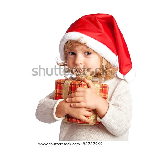 Baby holding Christmas gift. Isolated on white - stock photo