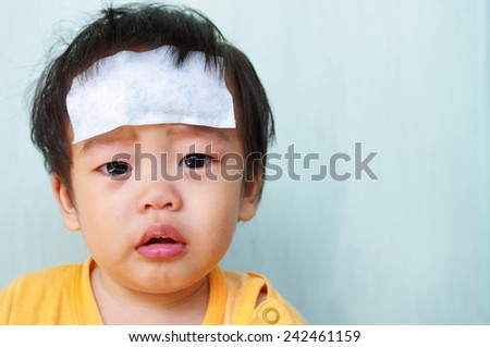 Baby illness medicine flu fever and cooling forehead. - stock photo