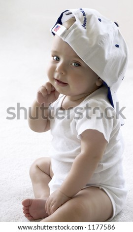 Baby in a baseball cap with american flag on it