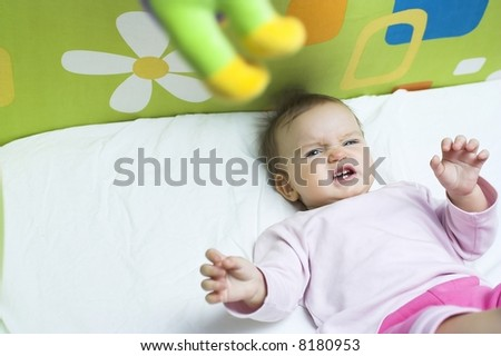 Baby  in a Crib - angry - stock photo