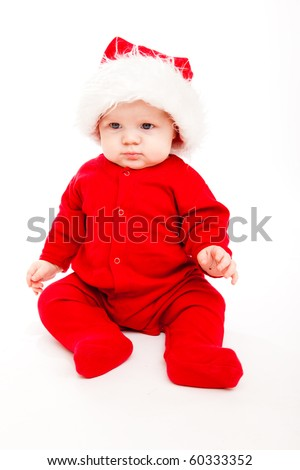 Baby in a red Santa hat and costume