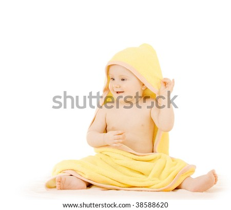 Baby in a yellow towel on white background - stock photo