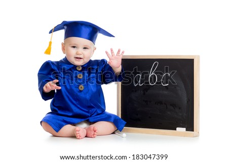 Baby in academician clothes  sitting at chalkboard - stock photo
