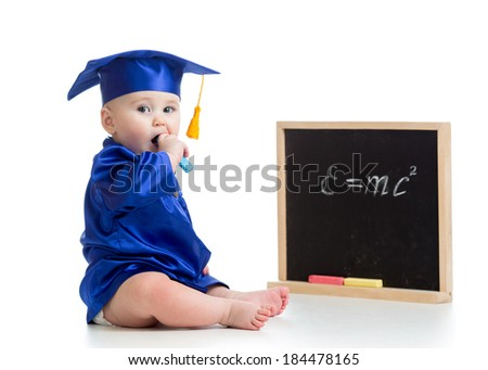 Baby in academician clothes  with chalk at blackboard - stock photo
