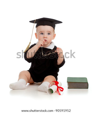 Baby in academician clothes  with roll and book - stock photo
