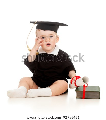 Baby in academician clothes  with roll and book