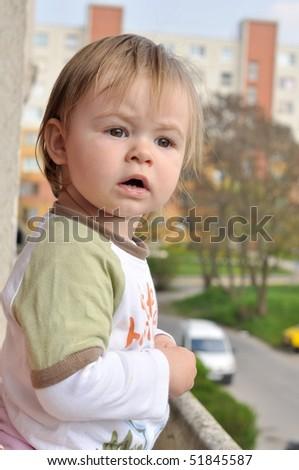 baby in balcony - stock photo
