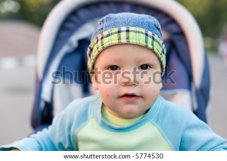 Baby in bandanna sitting stroller #13. View my another photos from this series. - stock photo