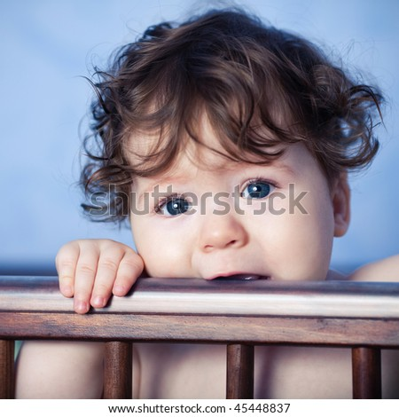 baby in bed - stock photo