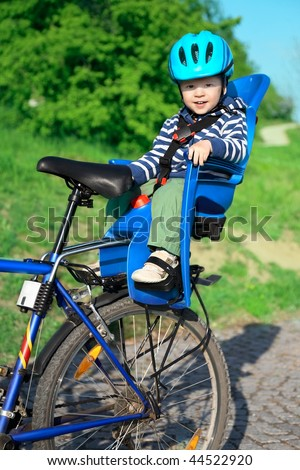 baby in bicycle chair - stock photo