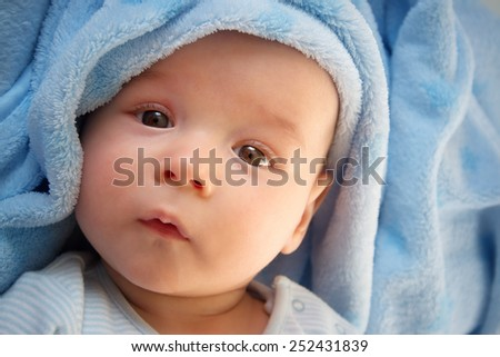 baby in blue blanket - stock photo