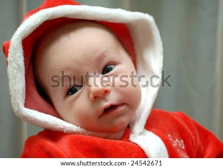 baby in Christmas bonnet looks - stock photo