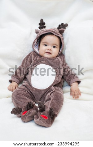 Baby in Christmas Reindeer Costume on White background. - stock photo