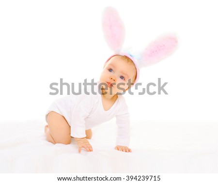 Baby in easter bunny ears on a white background - stock photo