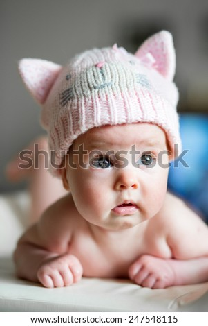 baby in funny cat hat - stock photo