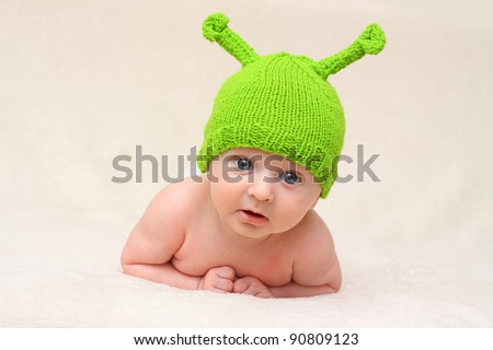 baby in funny green Christmas hat - stock photo