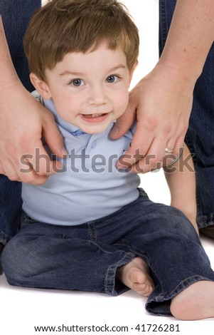 Baby in jeans on a white background