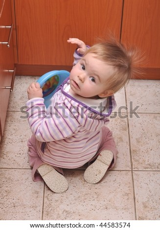 baby in kitchen - stock photo