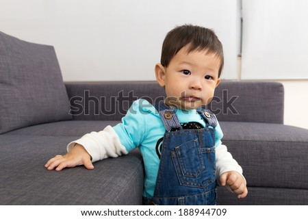 Baby in living room  - stock photo