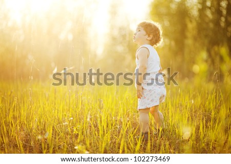 Baby in nature - stock photo