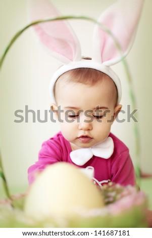 Baby in rabbit costume - stock photo
