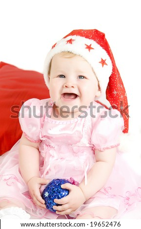 Baby in red christmas  hat with blue ball in hands on white ground