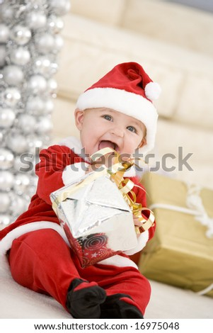 Baby In Santa Costume At Christmas - stock photo