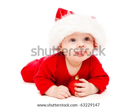 Baby in Santa hat with Christmas decoration - stock photo