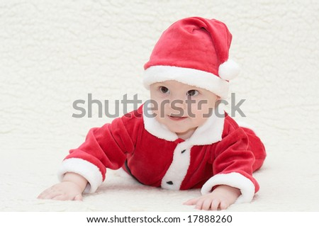 baby in santa's suit - stock photo