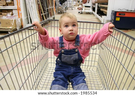 baby in shop carriage - stock photo