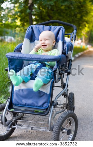 Baby in sitting stroller #10 - stock photo