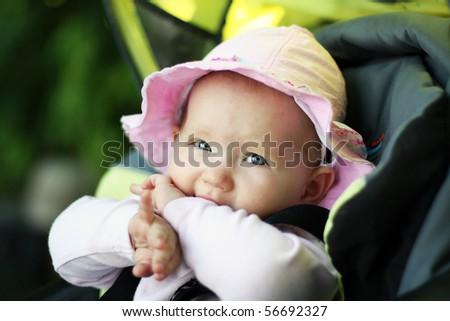 Baby in sitting stroller - stock photo