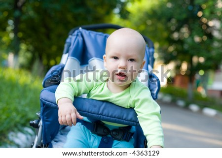 Baby in sitting stroller #11. View my another photos from this series. - stock photo