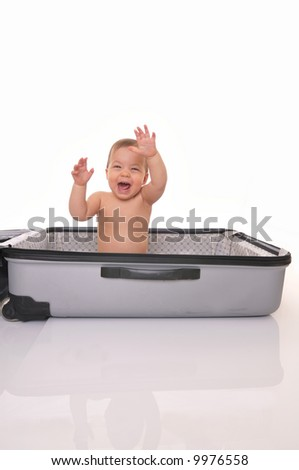 Baby in suitcase - stock photo