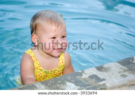Baby in Swimming Pool - stock photo