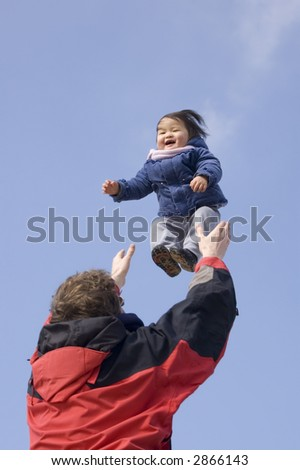 baby in the air - stock photo