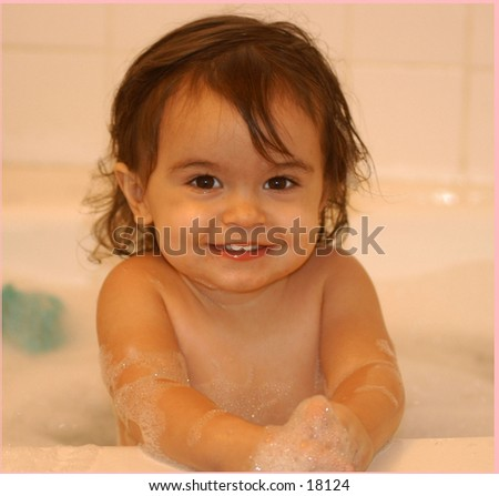 Baby in the bath smiling