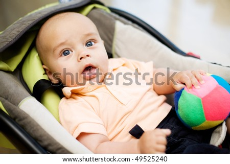 Baby in the car seat - stock photo