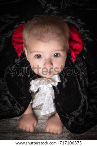 baby in the costume of Dracula - halloween concept