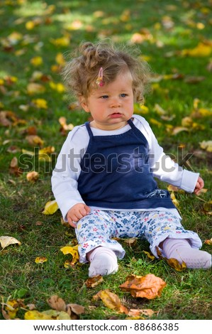 baby in the fall-meadow