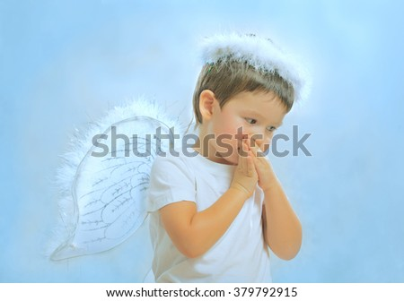 BABY IN THE SUIT OF THE ANGEL