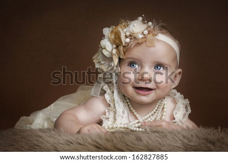 Baby in vintage dress - stock photo