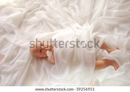Baby in White - stock photo