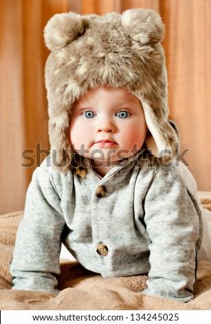 baby in winter fur hat - stock photo