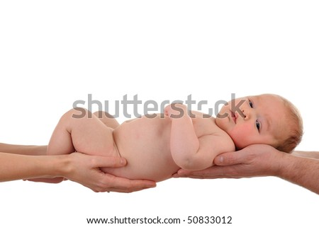 Baby is being held by the parents (hands visible). Symbolizing trust, love, care and responsibility. Background is white. - stock photo