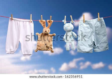Baby is born ���  Boy or a girl on the outdoor clothesline - stock photo